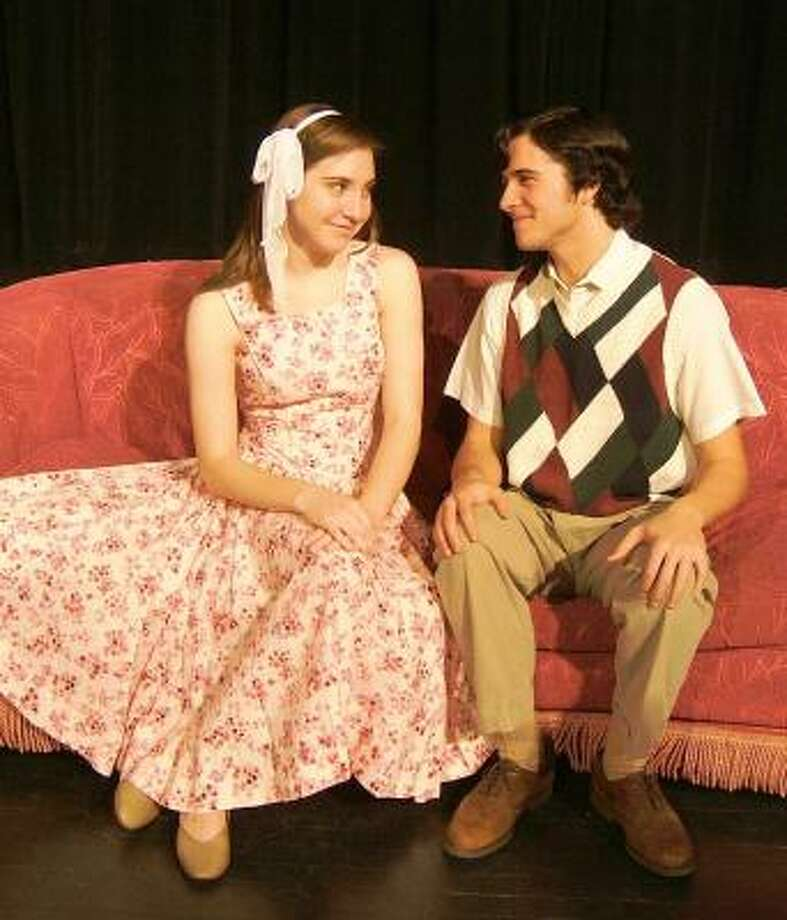 """Kim MacAfee, played by Caroline Badalamenti,  accepts a proposal to go steady from Hugo Peabody, played by Douglas Copeland in the musical, """"Bye Bye Birdie,"""" at Seven Lakes High School."""