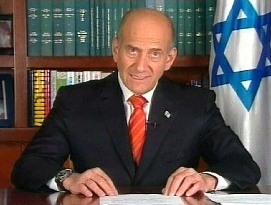 """Israeli Prime Minister Ehud Olmert goes on TV after a commission sharply criticized his conduct of the war in Lebanon to tell his fellow citizens, """"It would not be correct to resign."""" Photo: AP"""