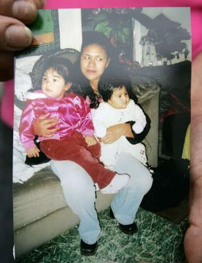 Gilberta Estrada was found dead along with three daughters, including Janet Frayre, left, and Magaly Frayre. Photo: Tony Gutierrez, AP