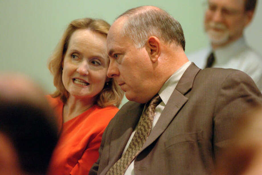 North Harris Montgomery Community College District's new chancellor, Dr. Richard Carpenter, and his wife, Dana, wait for the NHMCCD Board of Trustees meeting to begin Thursday. Photo: David Hopper, For The Chronicle