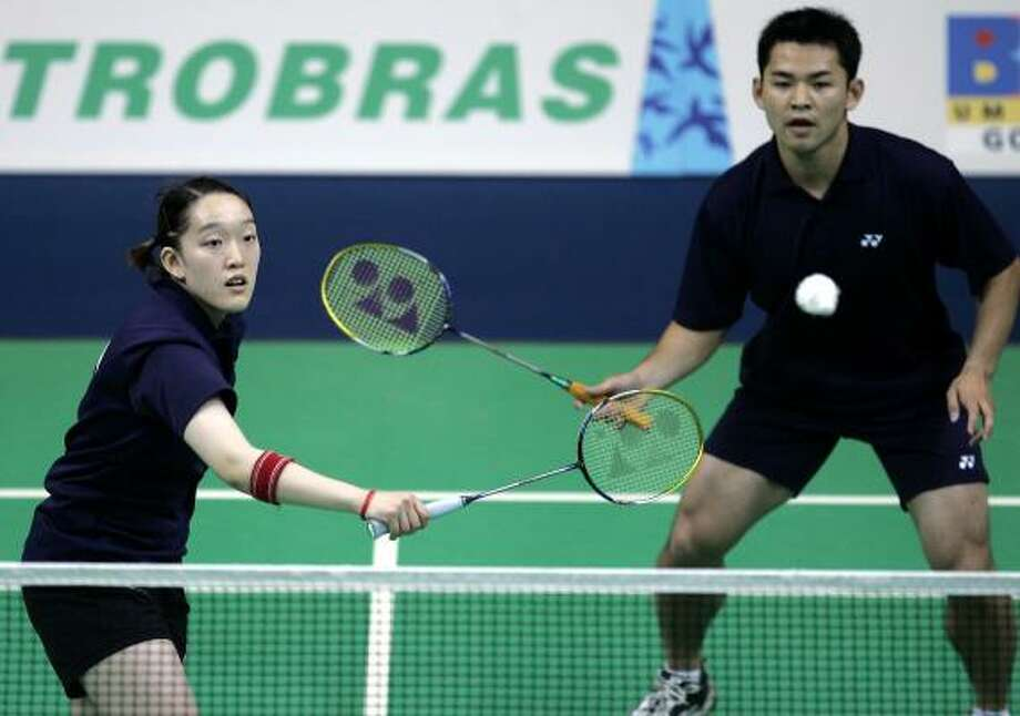 Eva Lee and Howard Bach of the U.S., shown in their Pan American Games badminton mixed doubles finals, became fan favorites in a unique way. Photo: ARMANDO FRANCA, ASSOCIATED PRESS