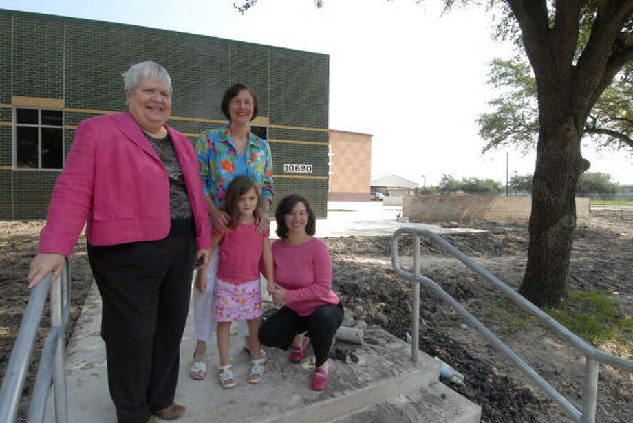Walnut Bend Elementary School Principal Sylvia Doyle, left, with longtime Walnut Bend resident Carol Tuttle and her granddaughter Alexa Garza and daughter Ashley Garza, said pupils will love the new campus. Tuttle said both her daughters, Ashley, 35, and Courtney, 38, attended Walnut Bend Elementary. She said she couldn't be happier that her granddaughter will attend ``the quintessential neighborhood school.'' Photo: Tony Bullard, FOR THE CHRONICLE
