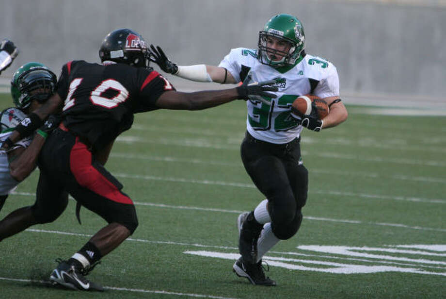 Luis Fierro and the Langham Creek defense kept Brady Atkinson and Mayde Creek on the run Saturday during the Lobos' 24-point victory. Langham Creek forced six turnovers in the game. Photo: GARY FOUNTAIN, FOR THE CHRONICLE