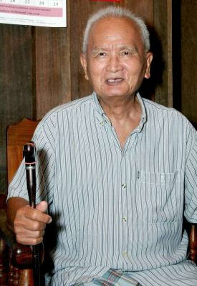 Nuon Chea speaks to the media at his home in Pailin on Tuesday, a day before he was arrested. Photo: ASSOCIATED PRESS