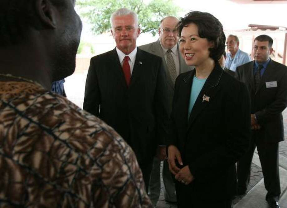 Secretary of Labor Elaine Chao visits with a Port of Houston worker on Wednesday after lauding partnerships at the port between labor and management. Photo: BILLY SMITH II, CHRONICLE
