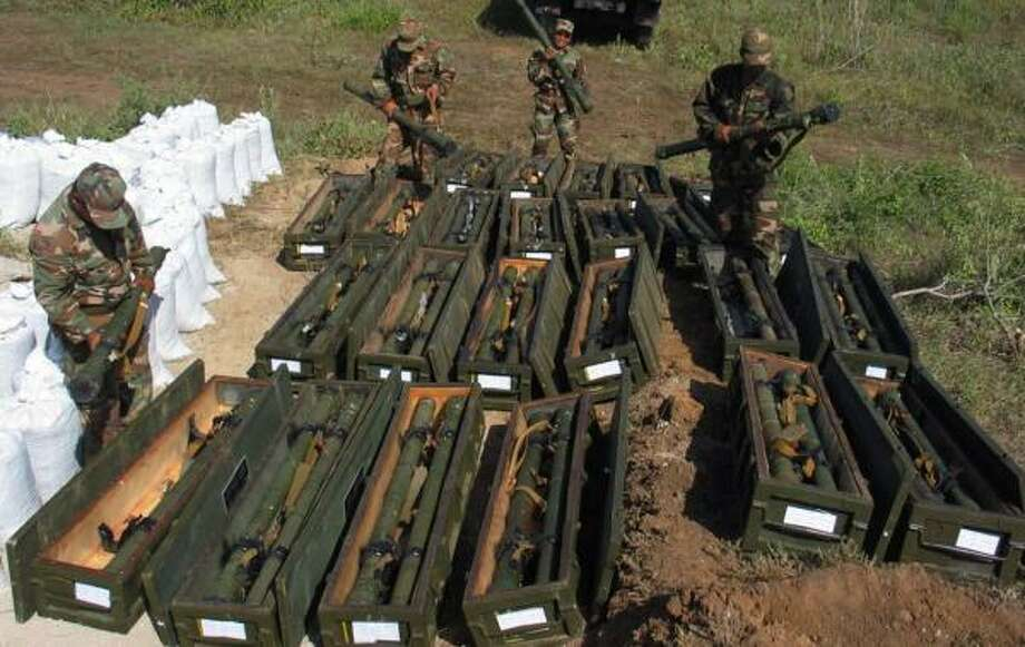 Nicaraguan soldiers inspect surface-to-air missiles they are guarding. U.S. officials fear the weapons could fall into the wrong hands. Photo: TOMAS ALEMAN, ASSOCIATED PRESS FILE