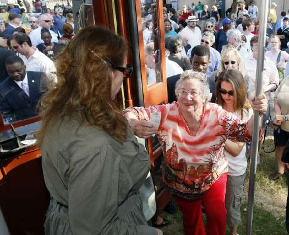Carol Hopper boards the newly-running streetcar on St. Charles Avenue. Sections of the line remain closed after Hurricane Katrina, but full service may be restored by next spring. Photo: ANN HEISENFELT, ASSOCIATED PRESS