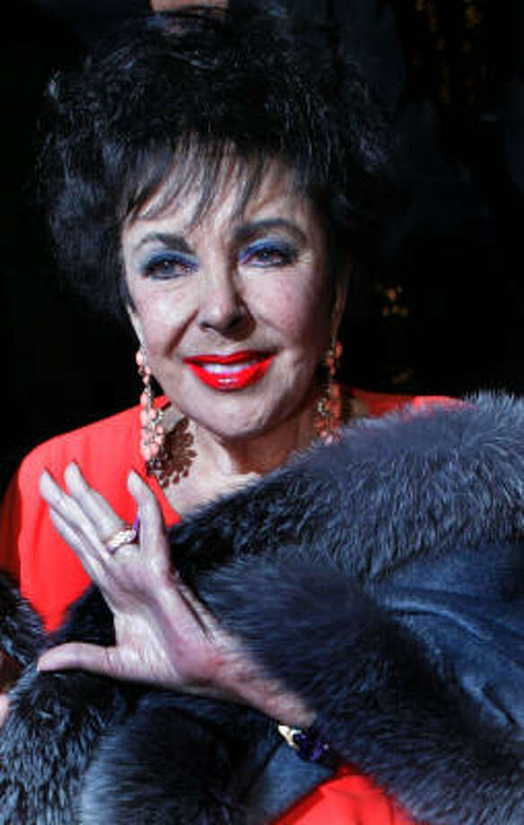 Elizabeth Taylor said she was grateful for the Writers Guild's agreement to not picket so she and her guests could enter the studio with a clear conscience. Photo: STEFANO PALTERA, Associated Press