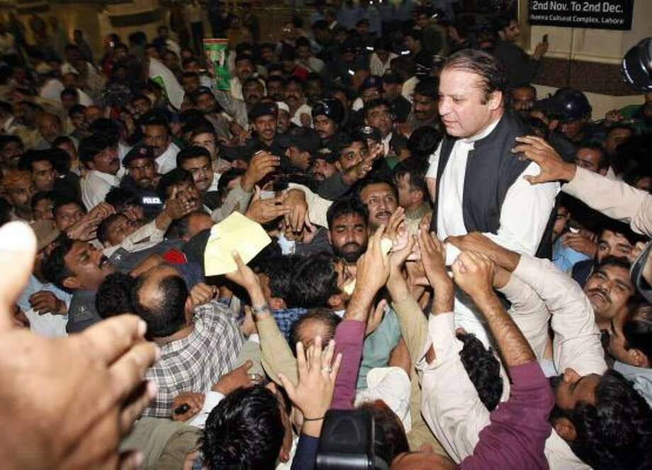 Former Pakistan Prime Minister Nawaz Sharif is met with overwhelming support after spending seven years in exile. He says he made no deal with President Pervez Musharraf in order to return. Photo: ARIF ALI, AFP/GETTY IMAGES