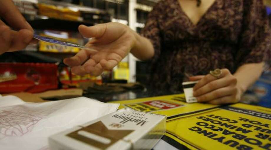 Consumption did not drop as dramatically as expected. But anti-smoking groups say they are not disappointed because 261 million fewer packs have been sold since Texas lawmakers raised the cigarette tax from 41 cents to $1.41 per pack in January. Photo: SHARÓN STEINMANN, CHRONICLE FILE