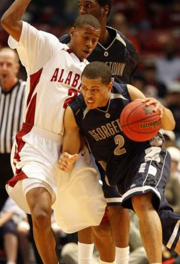 Georgetown's Jonathan Wallace, right, tries to get around Alabama's Mikhail Torrance on Wednesday. Photo: BUTCH DILL, AP
