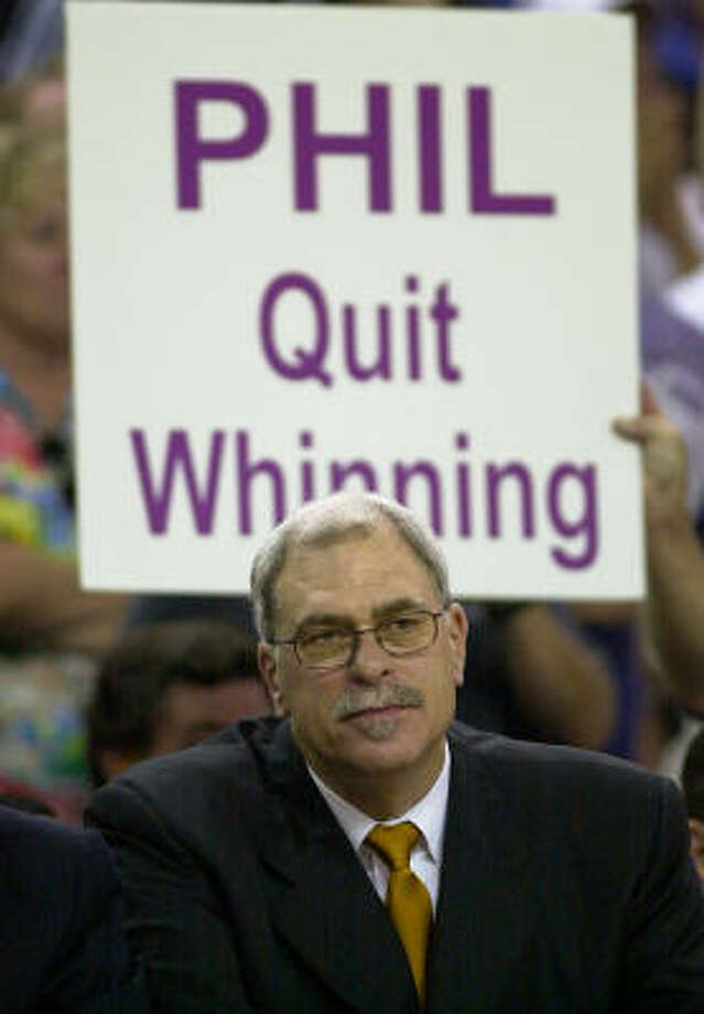 Phil Jackson's girlfriend says he had too much time on his hands while he was retired. Photo: MARK J. TERRILL, AP