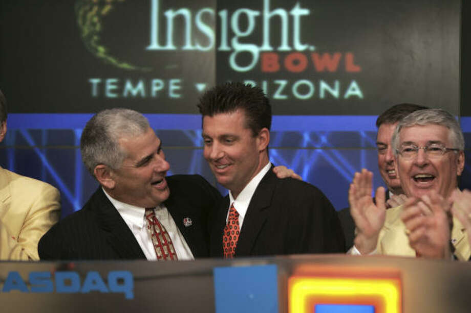 Indiana (with coach Bill Lynch, left, at a promotional appearance at the NASDAQ stock market) has seen more trouble than most teams. Photo: Rob Tannenbaum, AP