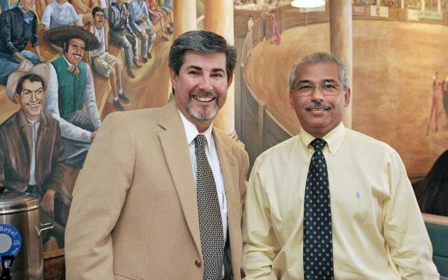 Javier Garza, president of the Cámara de Empresarios Latinos de Houston, and Gelacio Torres, right, owner of La Tapatia restaurants, embody the leadership and clientele, respectively, of a newer chamber focused on immigrant-run businesses. Photo: CRAIG H. HARTLEY, FOR THE CHRONICLE
