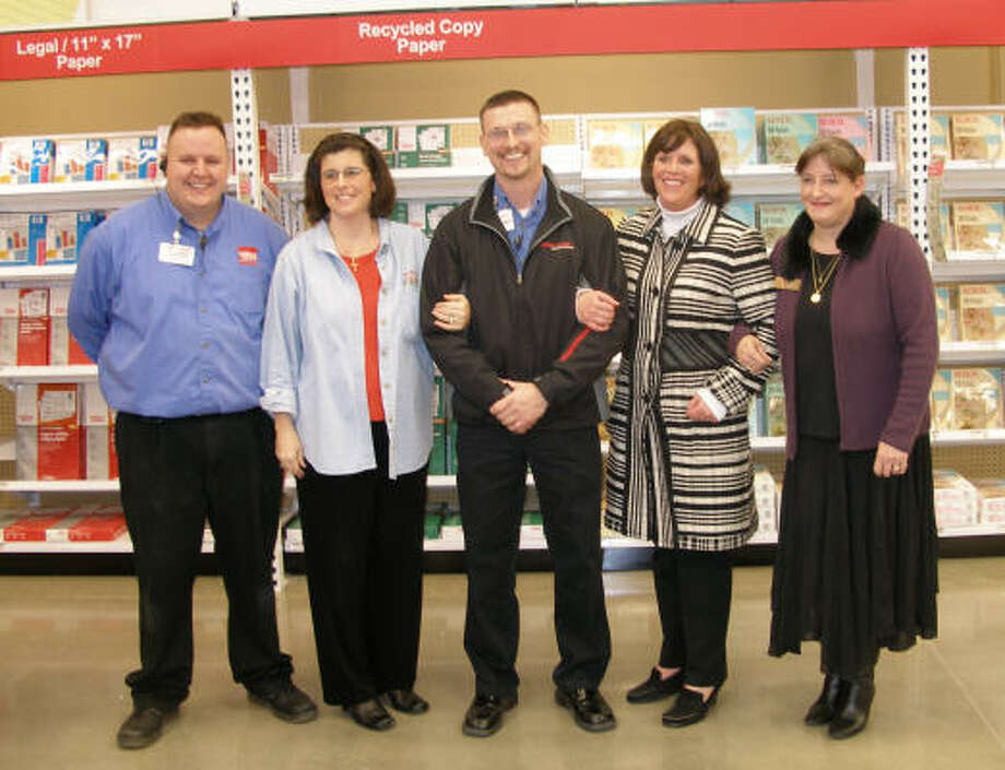 TheOffice Depot in Atascocita presented $500 in store merchandise to three local nonprofits during opening ceremonies. On hand were, from left, Jason Dyches,  Jennifer Dantzler, Chris Wilkes,  Mary Green, and Eva Leisenheimer. Photo: Harry Williamson, For The Chronicle