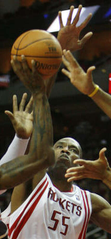 Dikembe Mutombo (55) had a double double against visiting Charlotte. Photo: Kevin Fujii, Chronicle