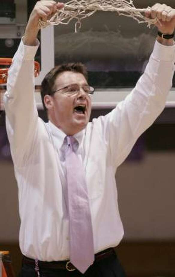 Coach Bill Gibbons celebrates Holy Cross' victory over American. Photo: GREG M. COOPER, AP