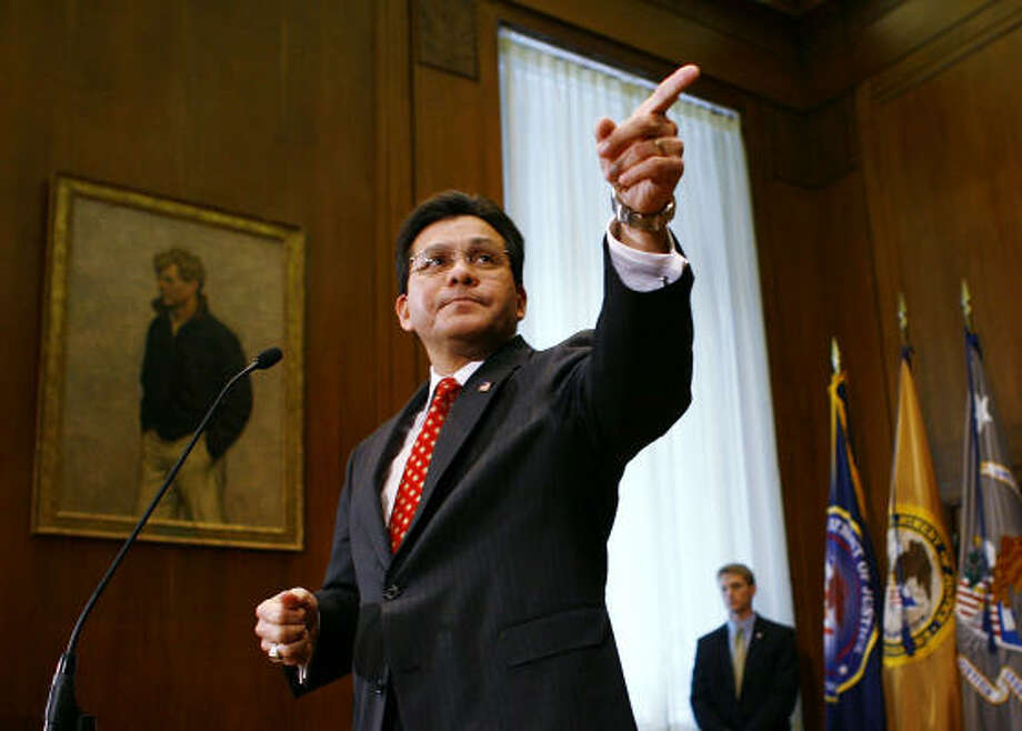 U.S. Attorney General Alberto Gonzales calls on a reporter for questions beneath a portrait of former Attorney General Robert Kennedy at a news conference. Gonzales was responding to criticism over the firings of eight federal prosecutors, which Democrats charge were politically motivated. Photo: Win McNamee, Getty Images File