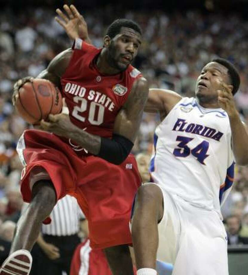 Greg Oden, left, pulls a rebound away from Florida's Marreese Speights, in a 25-point, 12-rebound game. Photo: MARK HUMPHREY, ASSOCIATED PRESS