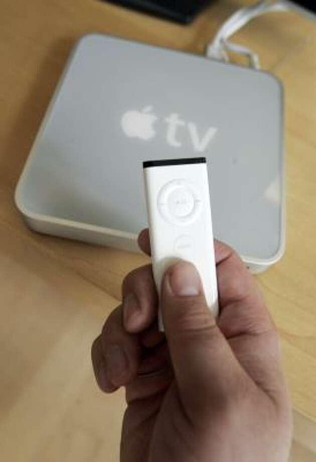 The Apple TV device comes with a remote control. Photo: PAUL SAKUMA, ASSOCIATED PRESS