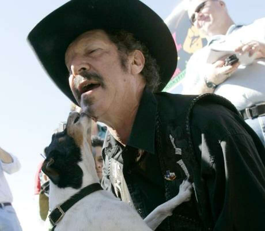 Kinky Friedman gets kissed by a dog during a campaign stop last year. Photo: ERIC GAY, Associated Press