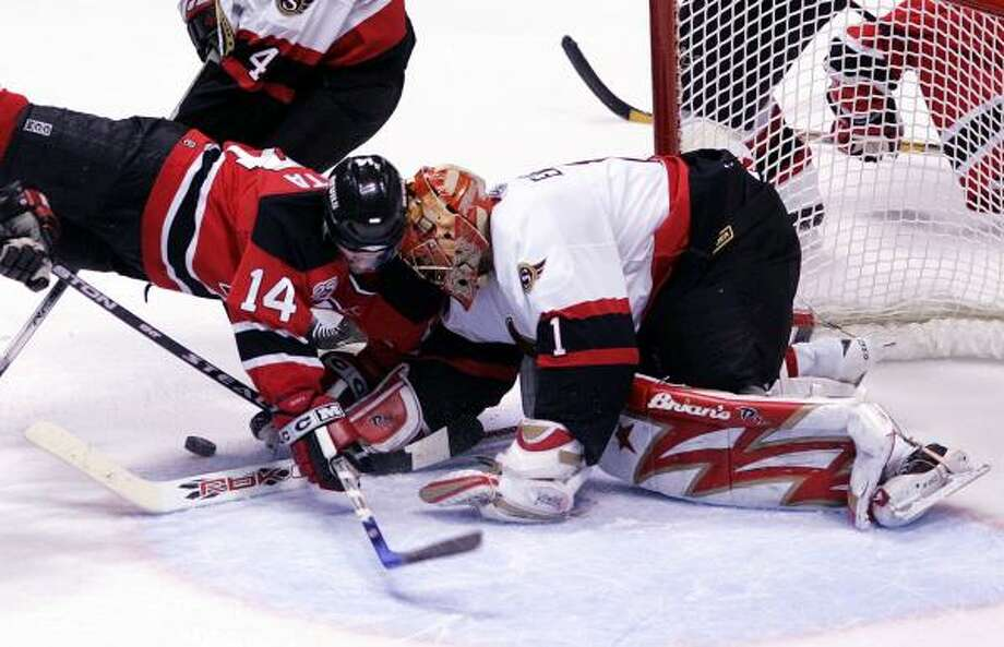 Brain Gionta (14) of the New Jersey Devils bangs helmets with Ottawa goalie Ray Emery in the third period of the Senator's series-clinching victory. Photo: Mel Evans, AP