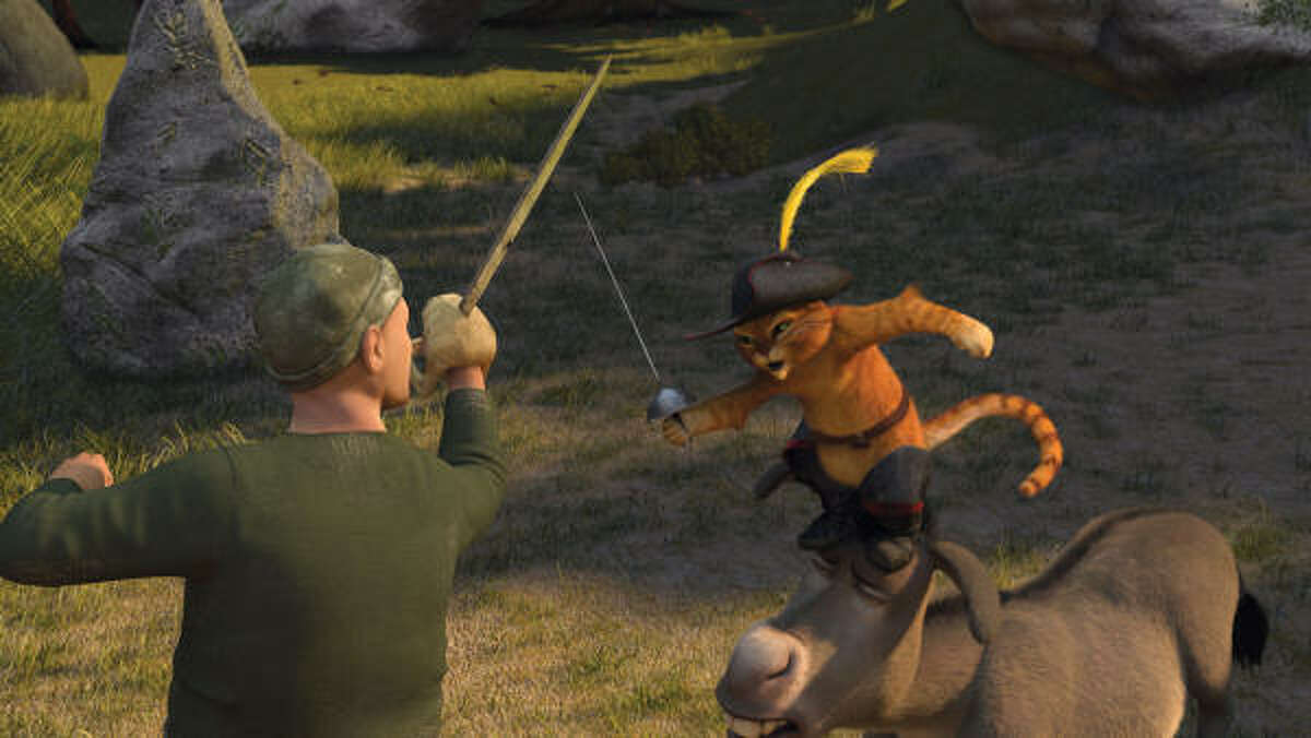 Puss In Boots (Antonio Banderas) and Donkey (Eddie Murphy) square off with one of Captain Hook's pirates in Shrek the Third.