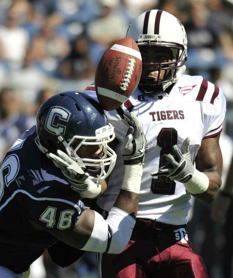 Connecticut's Sio Moore (46) attempts to grab a pass intended for Texas Southern's Joe Anderson, right, during a win last September. Photo: Jessica Hill/Associated Press / Connecticut Post