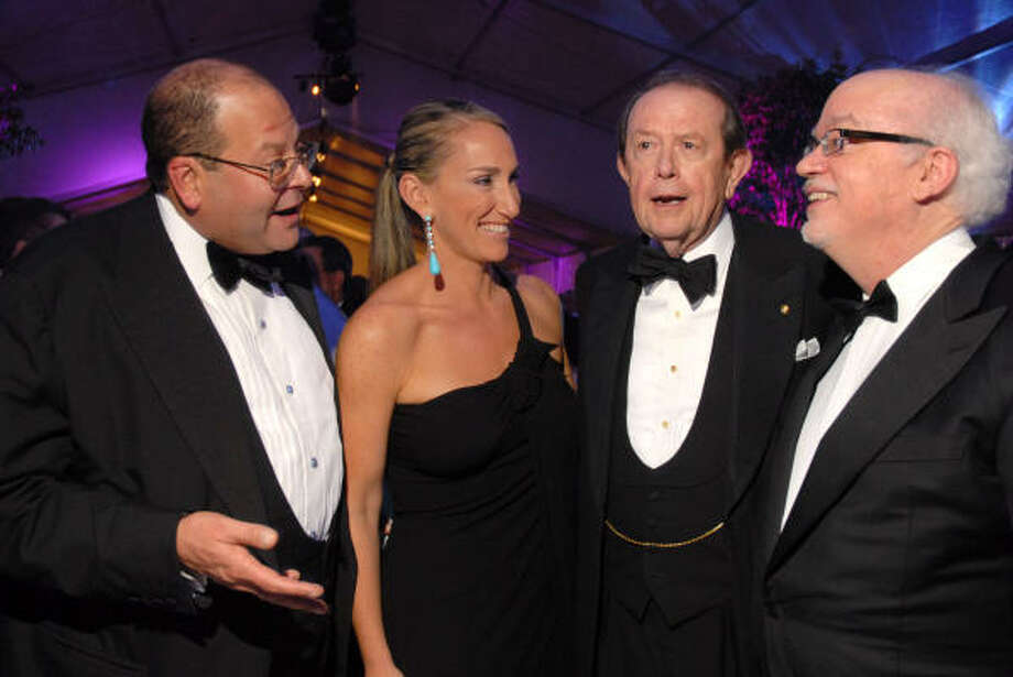 Alley Theatre ball chair Courtney Lanier Sarofim is surrounded by her leading men - husband Christopher Sarofim, from left, Alley chairman emeritus Meredith Long and Alley artistic director Gregory Boyd. Photo: Dave Rossman, For The Chronicle