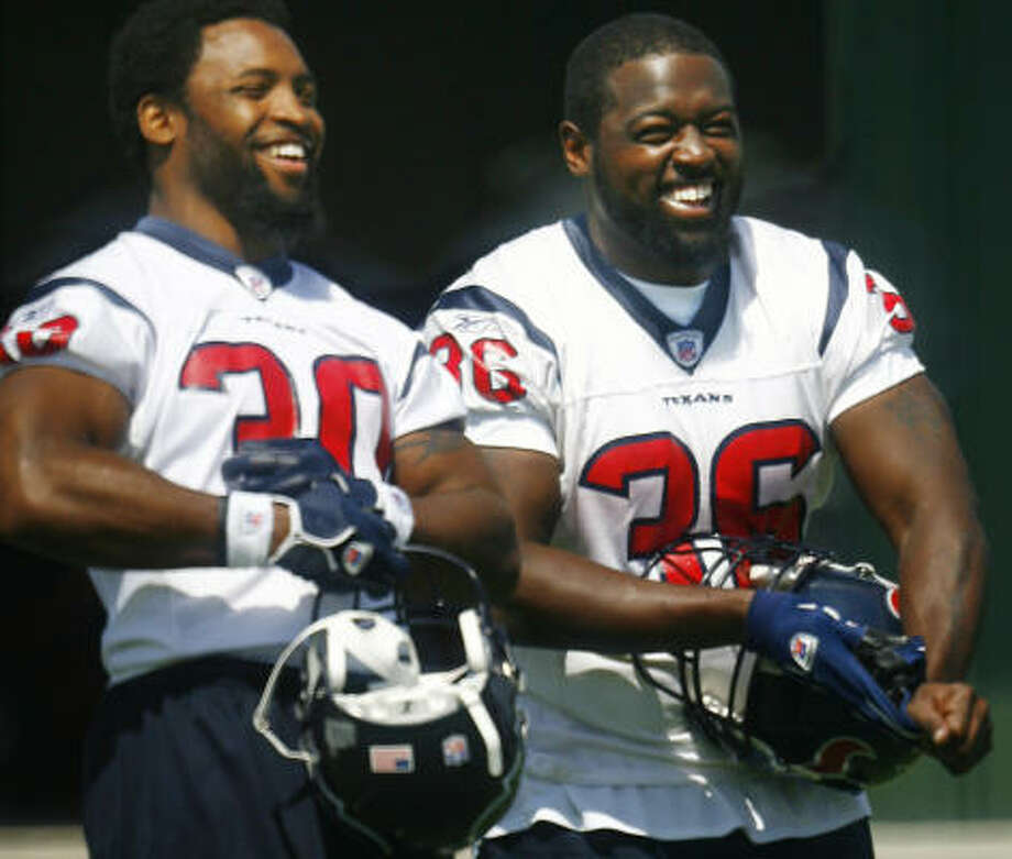 Sure, they're happy now, but how will Ahman Green and Ron Dayne (36) feel after games against the Colts, Chargers or Saints? Photo: Steve Ueckert, Chronicle