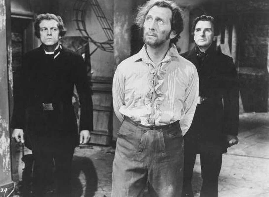 Peter Cushing, center, in a scene from The Curse of Frankenstein. Photo: Courtesy Photo