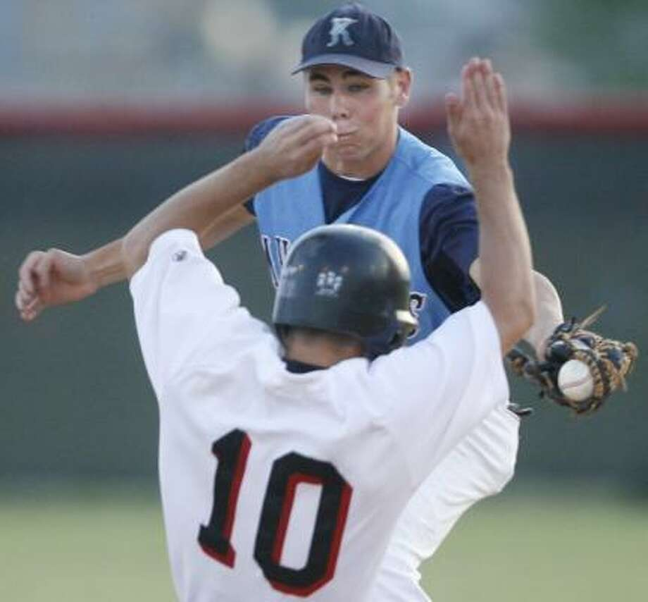 Langham Creek's Austin Freitas is forced out at second base by Kingwood shortstop David Tittle. Photo: KEVIN FUJII, CHRONICLE