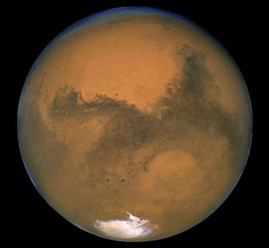 """The European Space Agency wants volunteers for a simulation to determine the """"human factor"""" in a possible trip to Mars. Photo: AP FILE PHOTO / NASA"""