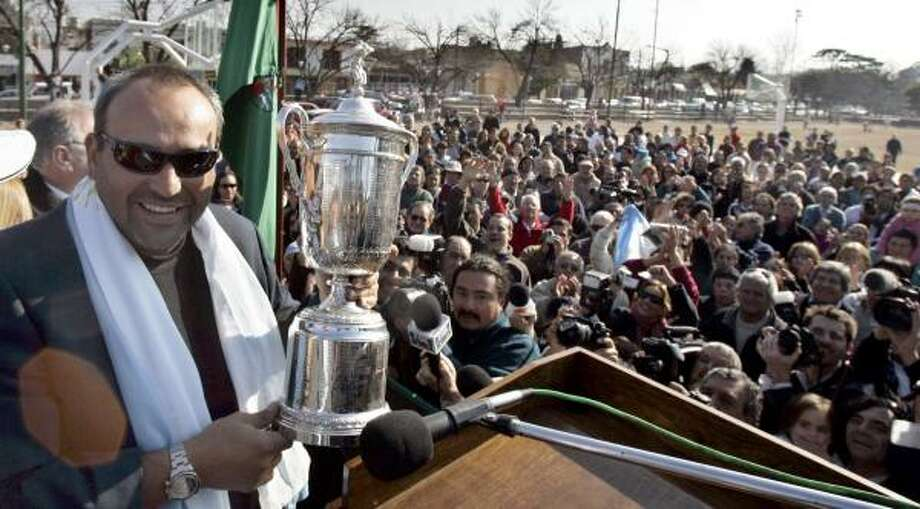 U.S. Open champion Angel Cabrera was greeted by large crowds in his return to Villa Allende, Argentina. His win and Manu Ginobili's NBA title have been big hits in soccer-mad Argentina. Photo: NATACHA PISARENKO, AP