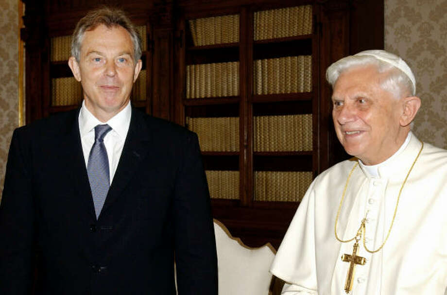 British Prime Minister Tony Blair is shown with Pope Benedict XVI at the Vatican on June 3, 2006. Blair is meeting again with the pontiff this weekend, fueling speculation that he might convert to Catholicism. Photo: OSSERVATORE ROMANO ARTURO MARI, AFP/Getty Images