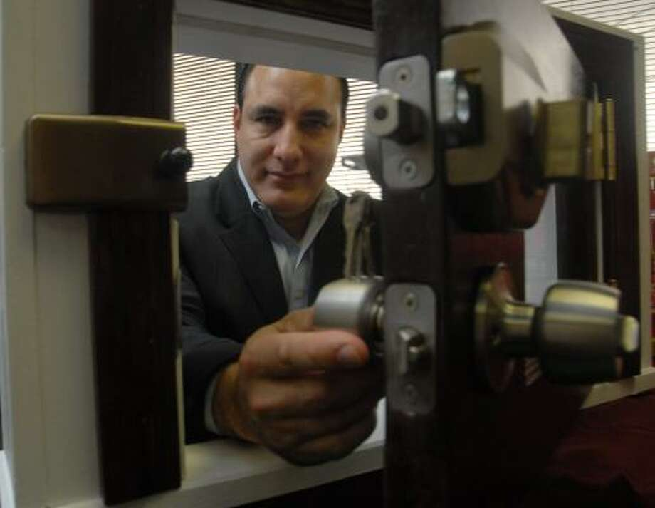 Ron Daniels, a former Harris County constable captain and owner of Millennium Locks, says his $249 Ultimate Lock can withstand a SWAT team with a battering ram. Photo: MEGAN TRUE PHOTOS, CHRONICLE