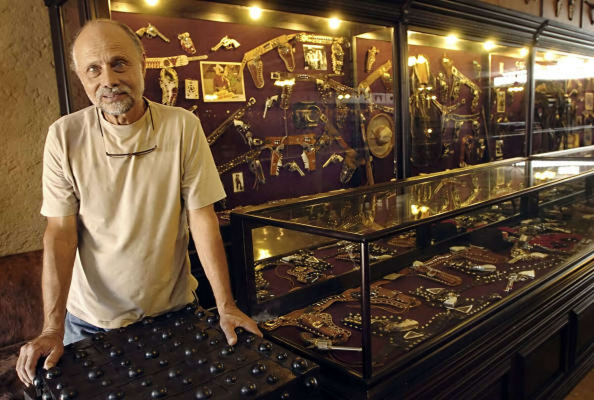Charles Trois, owner of more than 5,000 toy cap guns, stands among part of his collection May 29 at his museum in Enchanted Rock near Fredericksburg.