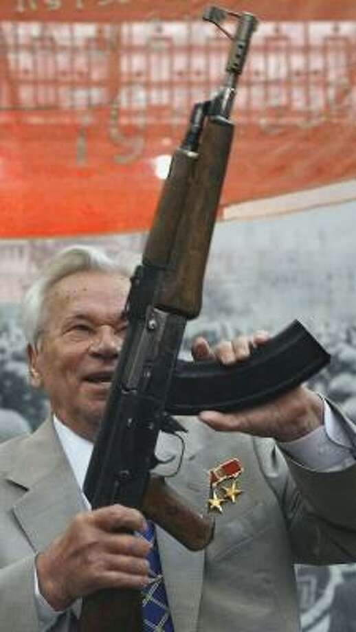 Mikhail Kalashnikov shows off his AK-47 Nr.1 prototype rifle during a 60th anniversary ceremony Friday in Moscow. Photo: MISHA JAPARIDZE, ASSOCIATED PRESS