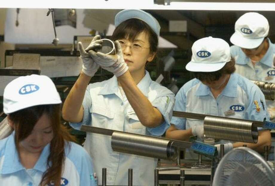 Workers inspect piston rings Monday at Riken Corp.'s plant in Kashiwazaki in north-central Japan, near the epicenter of the 6.8 earthquake last week. Photo: NIIGATA NIPPO VIA KYODO NEWS