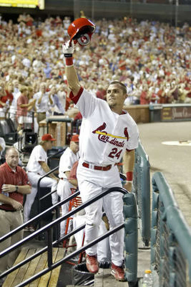 Rick Ankiel takes a curtain call after hitting a three-run homer to help the Cardinals beat the Padres 5-0. Photo: Tom Gannam, AP