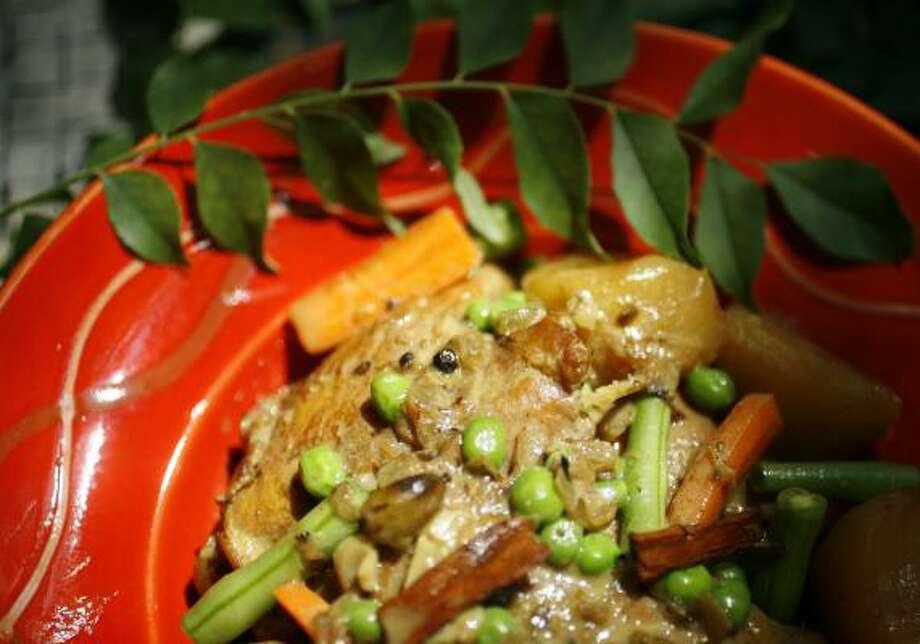 COASTAL CUISINE:Suneeta Vaswani's Kerala Chicken Stew (Koshi Ishtu) is a savory dish made with whole spices. Photo: SHARÓN Steinmann, Chronicle