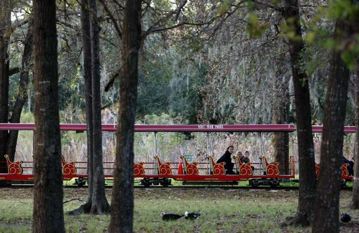 Alida Olson, son Anders, 2, and daughter Olivia, 4, ride Monday on Hermann Park's train, which makes its last stop Jan. 1. A new version opening in March will service museums and link to light rail.