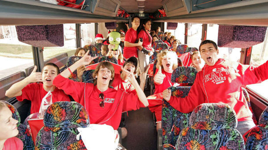 Katy band members get ready to leave the school for the Tigers' state championship game in San Antonio. Photo: Craig Hartley, For The Chronicle