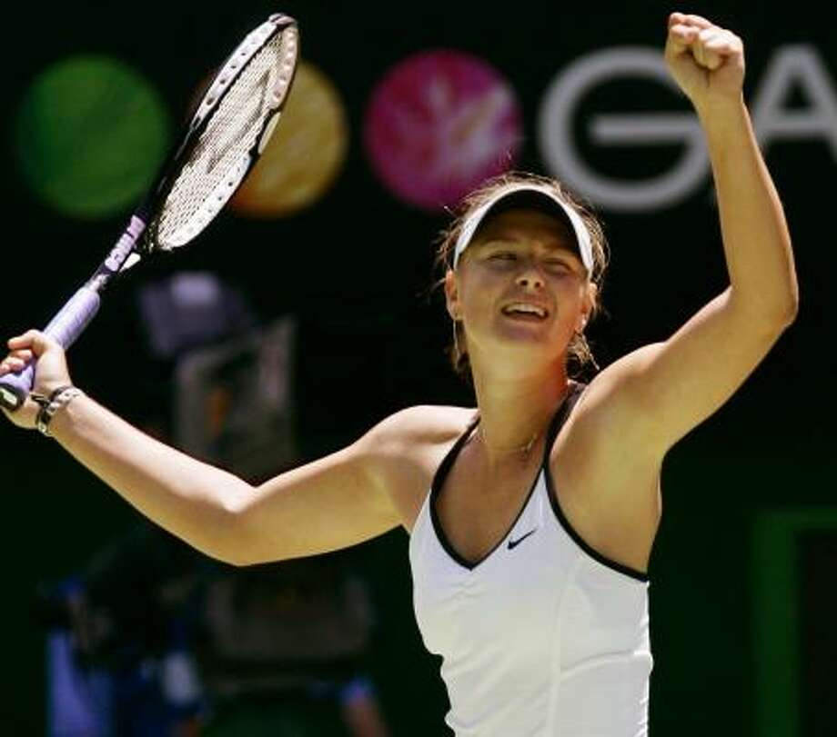 Maria Sharapova celebrates after advancing to the semifinals with a win over Anna Chakvetadze. Photo: ROB GRIFFITH, ASSOCIATED PRESS