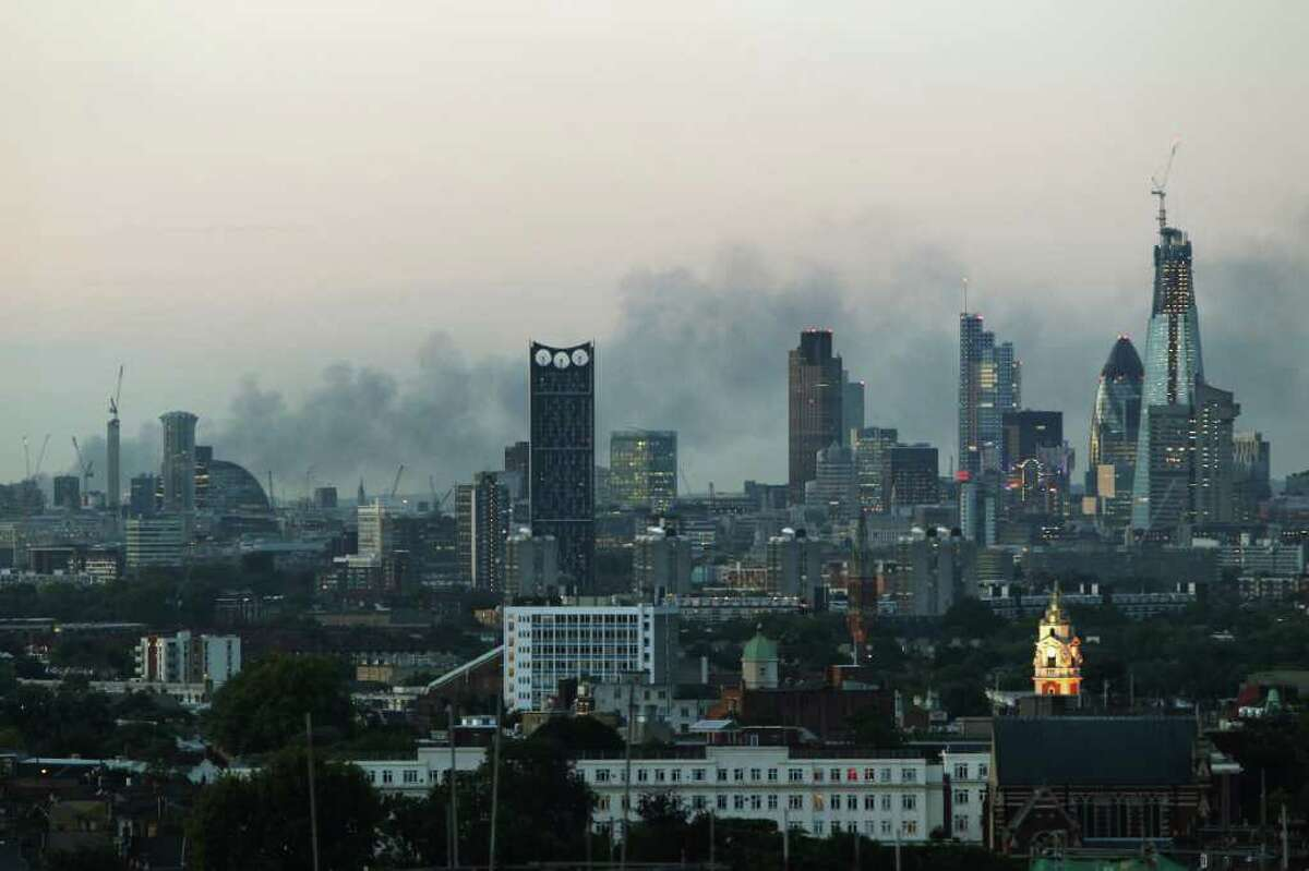 Smoke continues to drift across the London skyline on August 9, 2011.