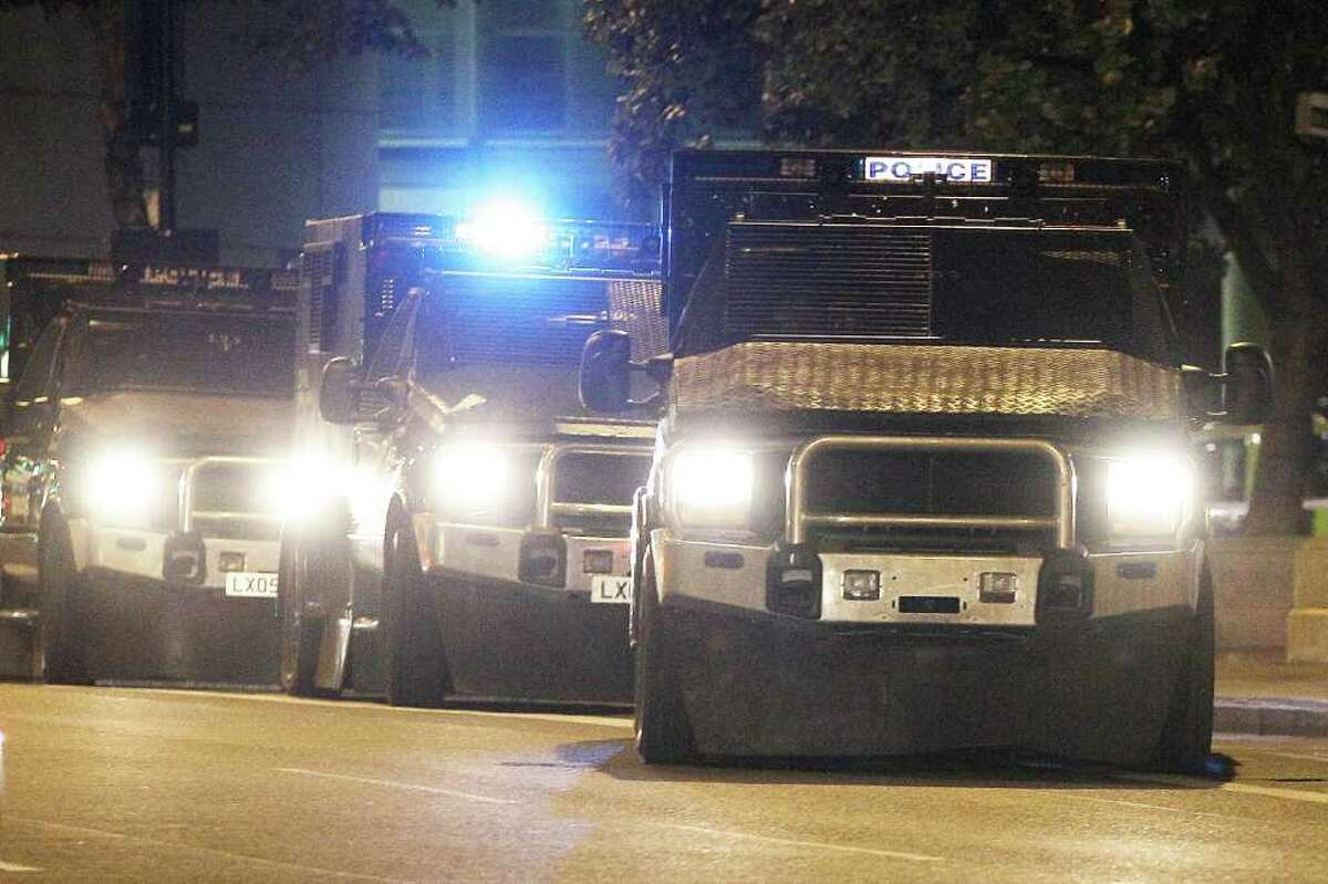 Police riot vehicles patrol Hackney to prevent disturbances on August 9, 2011 in London.