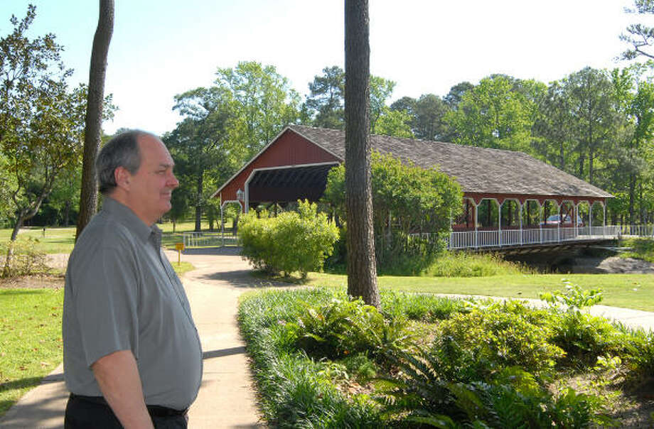 Ron Craig, treasurer and former president of the River Plantation Community Improvement Association, stands near the River Plantation bridge. Thirteen years ago, a flood devastated the 1,200-home community on the banks of the San Jacinto River. Since the flood, the 40-year-old community with about 3,000 residents has flourished. Home sale prices increased by 7.6 percent last year, according to data from Crawford Realty. Photo: David Hopper, For The Chronicle