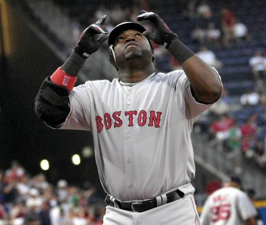 The Red Sox's David Ortiz celebrates his two-run homer in Wednesday's 11-0 laugher over the Braves. Photo: GREGORY SMITH, ASSOCIATED PRESS
