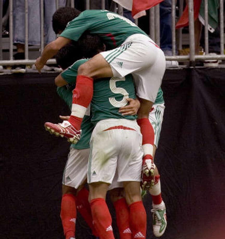Mexico players celebrate after Jared Borgetti's match-winning goal on Sunday. Photo: Brett Coomer, Chronicle