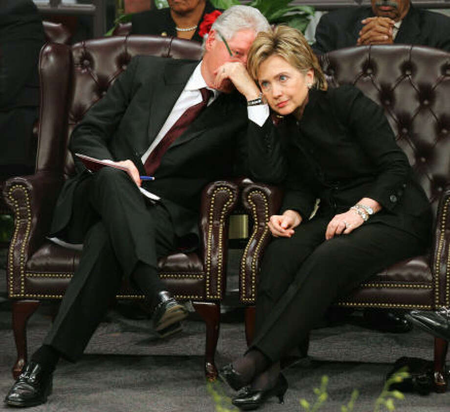 Former President Bill Clinton, left, talks with his wife, Sen. Hillary Rodham Clinton, D-N.Y., during the Coretta Scott King funeral ceremony at the New Birth Missionary Baptist Church in Lithonia, Ga., in Feb. 2006. Photo: RIC FELD, AP